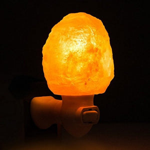 Natural Hand Carved Himalayan Salt Crystal Night Light at Dark