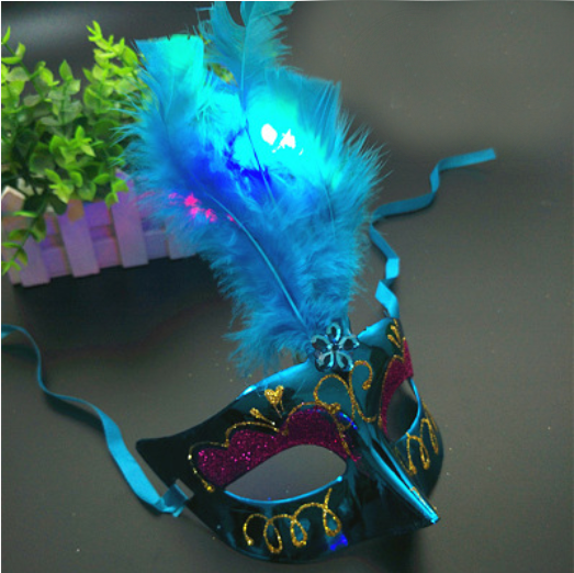 Glitter & Glowing Feather Mask with Just the Right Amount of Sparkle