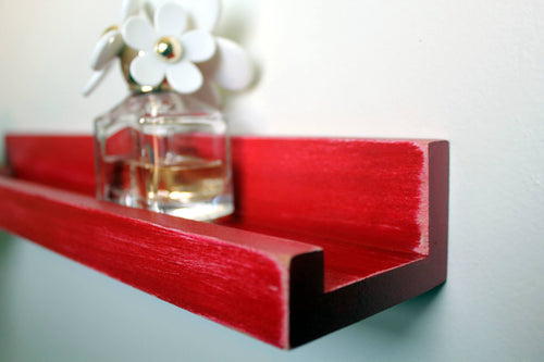 JTWoodworks red distressed ledge style shelf is perfect for organizing small items and displaying pictures or books within your home. It is also great in your office, studio, gallery or studio for displaying products and holding supplies.
