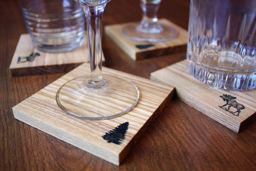 JTWoodworks wooden pine tree and moose coaster set will bring a touch of Maine into your home. Great barware for parties and entertaining at home.