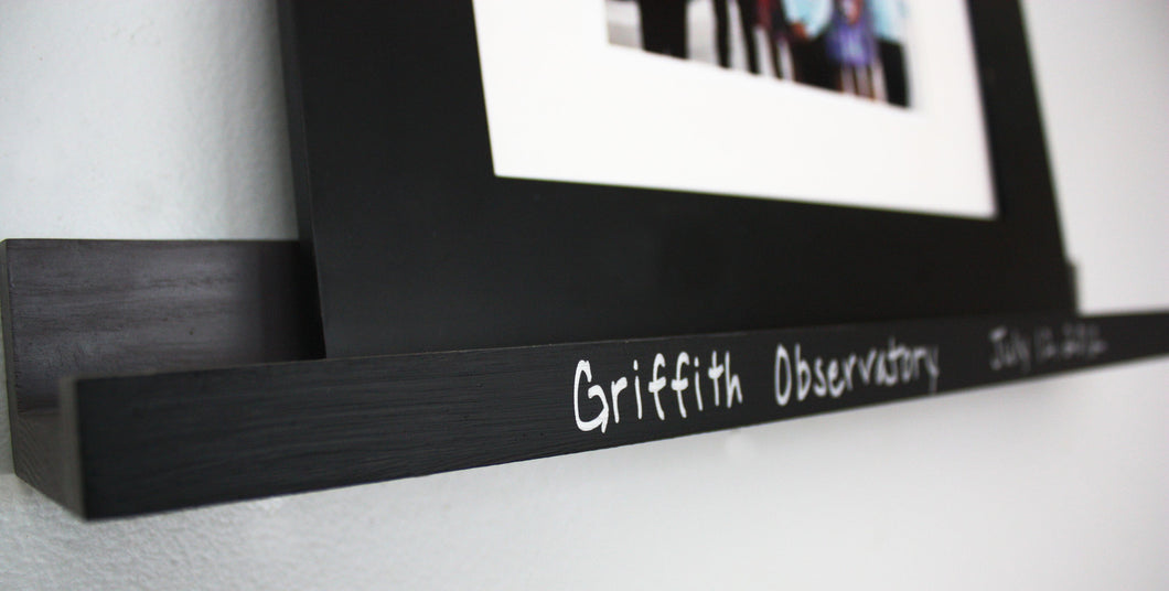 JTWoodworks narrow floating ledge shelf is perfect for displaying and commemorating photographs or special mementos. The writable chalkboard accented lip allows you to commemorate your display shelf with a personalized message.
