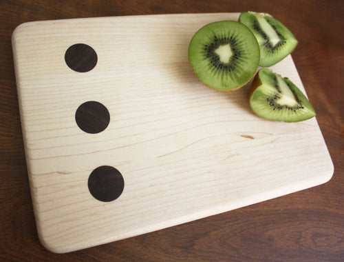 JTWoodworks unique wooden polka dot cutting board perfect for food prep and serving. This polka dot cutting board is great for food prep and serving.