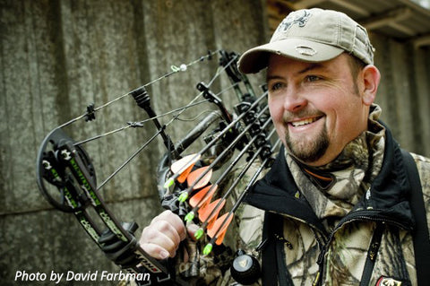 "Bone Collector's Travis ""T-Bone"" Turner poses with his archery equipment for an Outdoor Channel photo shoot."