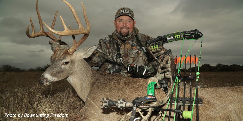 "Travis ""T-Bone"" Turner poses with a buck and his archery equipment after a big hunt."