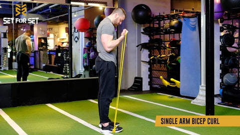 how to do bicep curls with resistance bands