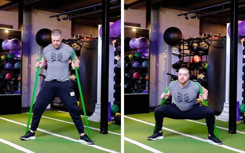sumo squat with resistance band
