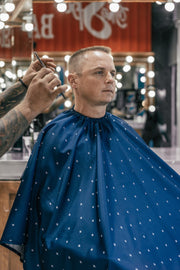 Barber Cape with Blue Shield Pattern | Durable Barber Cape with Nano-Technology | Barber Shop Cape Repels Hair and Water