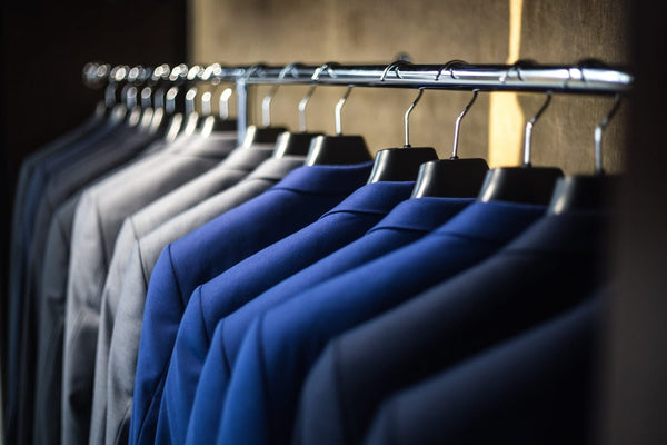 Classic mens suits on a rack ready for purchase