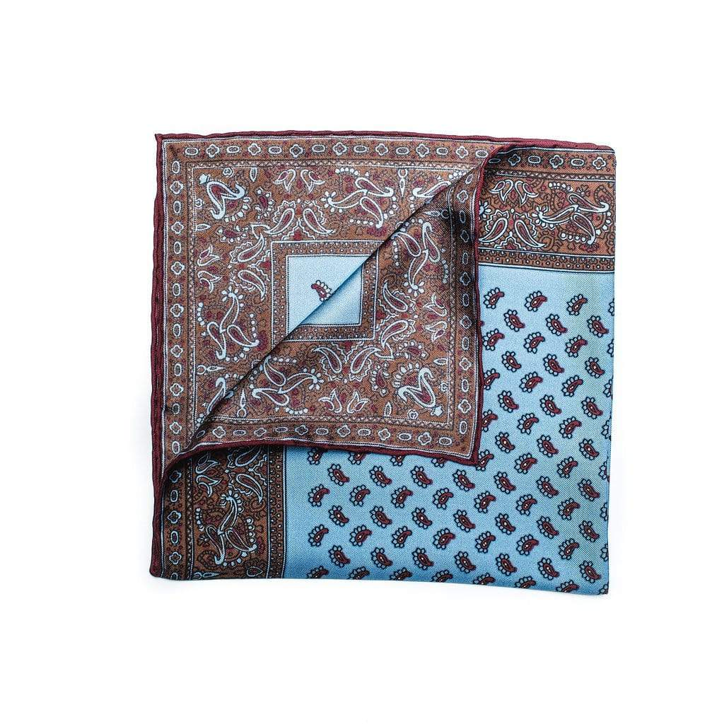 100% pure silk pocket square features a micro paisley motif, edged with decorative paisley border pattern. Sky Blue silk with butterscotch and burgundy edging rounds out this gorgeous decorative sartorial accessory.