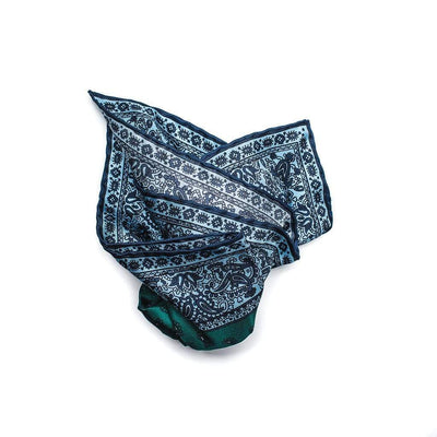 100% pure silk pocket square features a micro paisley motif, edged with decorative paisley border pattern. Its forest green silk with sky blue and navy edging provides layers of complexity that will accent many outfits.