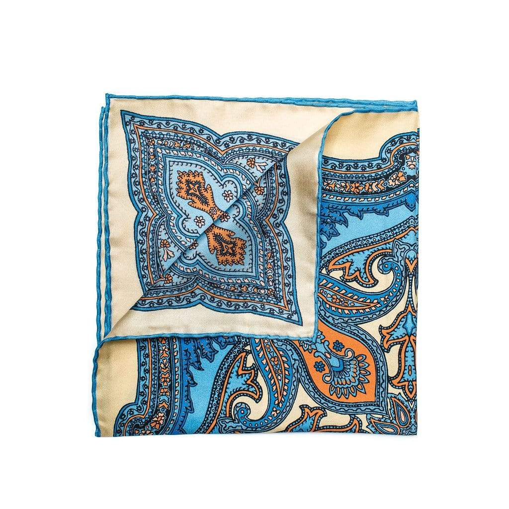 100% Pure silk pocket square Its butter-yellow with sky, primary blue and orange paisley pattern brings you somewhere warm
