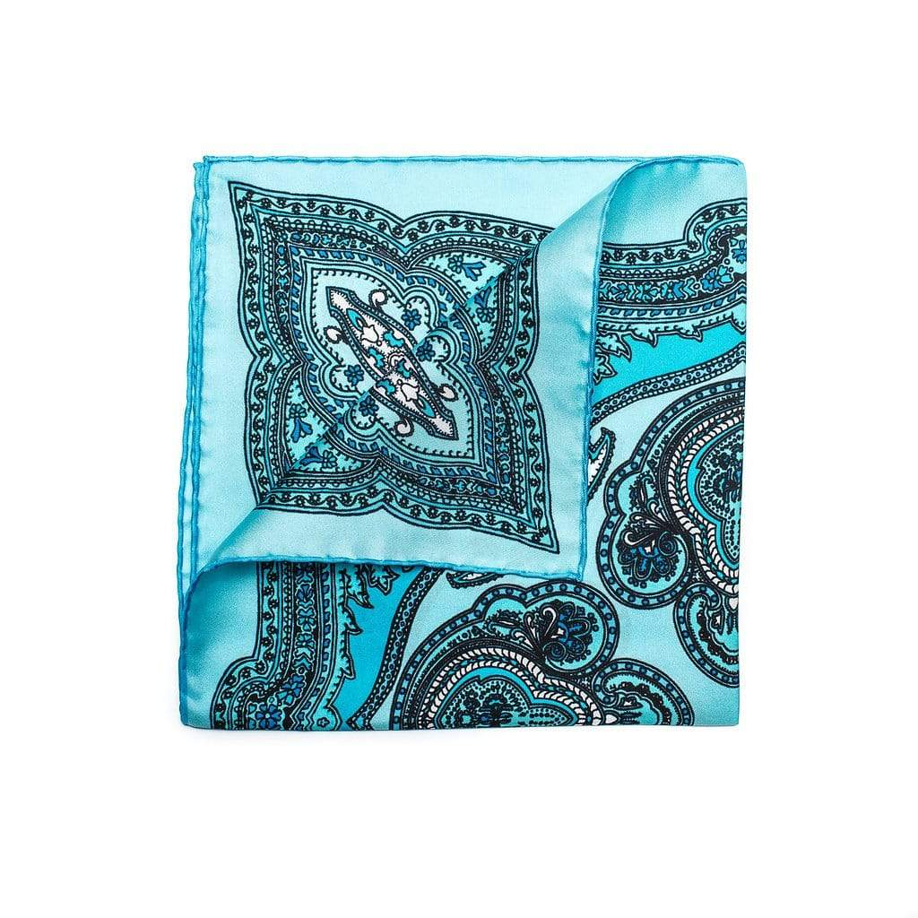 Men's Pocket Square made of 100% pure silk from Como Italy. It is bright blue with a paisley motif