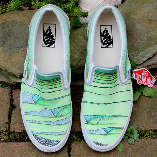 Green surfing swell lines custom designed Vans classic slip on sneakers