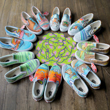 collection of custom designed vans for a wedding party