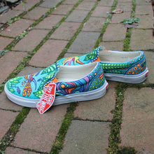 colorfully patterned lizard Custom designed Vans Classic Slip on shoes