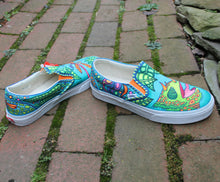chameleon tongue artwork drawn on  Custom designed Vans Classic Slip on shoes