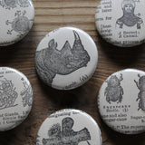 Intriguing pinback buttons for sale by RadCakes with original antique artwork