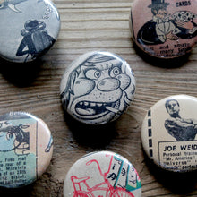 Underground comic book buttons pin backs by RadCakes for sale at the Trenton Punk Rock Flea Market