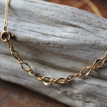 Gold chain jewelry with fossils by RadCakes