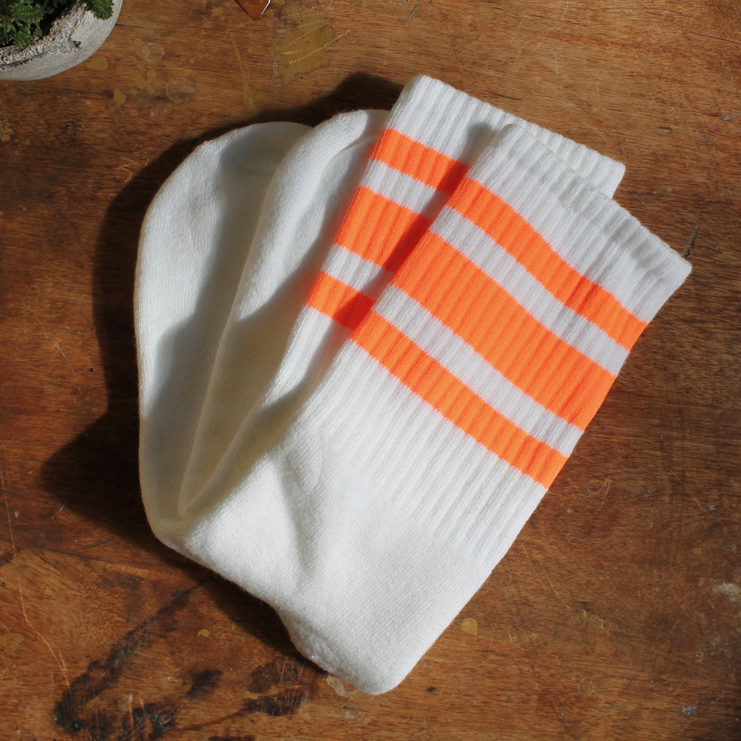 Neon Orange tube socks for sale retro skateboarding style fashion with stripes