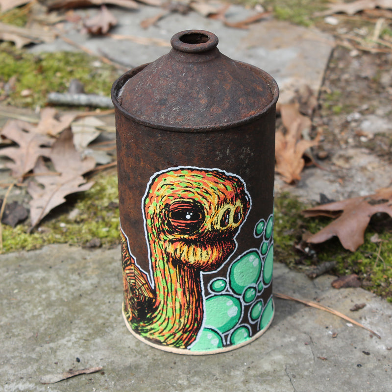 Original Tortoise artwork on an old oil can