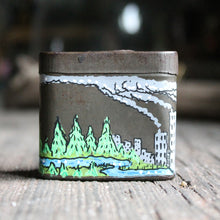 "Original artwork on an antique tin: ""The Industrial Monster"""