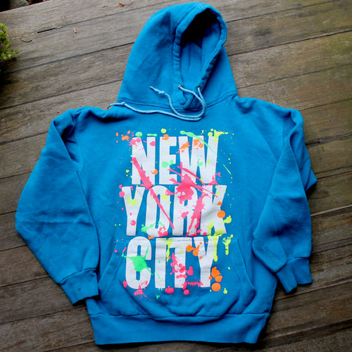 Thrift store New York City hooded sweatshirt with neon splatter design 1980s