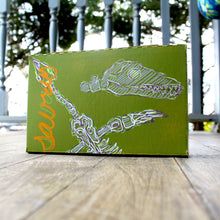 dinosaur skeleton artwork design monthly shirt box by RadCakes