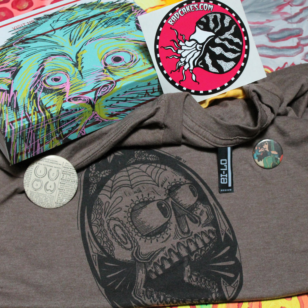 monthly shirt subscription box delivery by RadCakes custom artwork stickers and pinback buttons