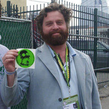 zach galifianakis at SXSW with RadCakes sticker before stand up comedy show