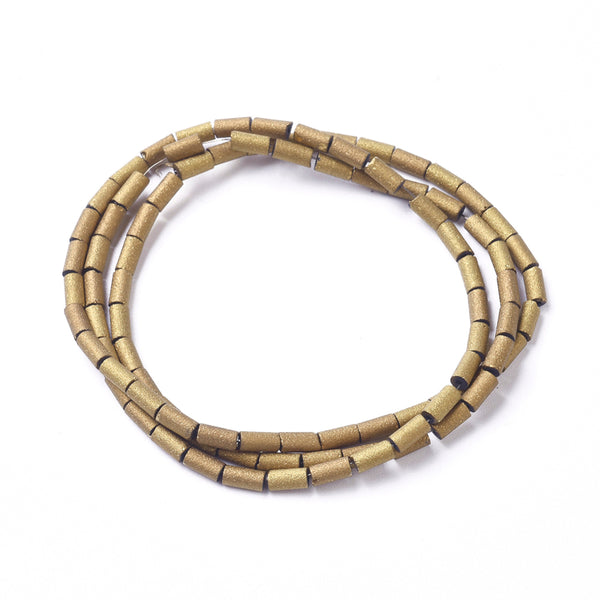 Electroplated gold glass bead