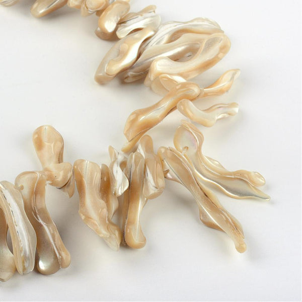 Honey shell piece strand