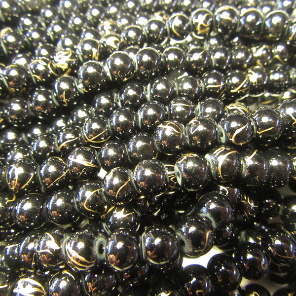 Black glass beads with Gold Vein