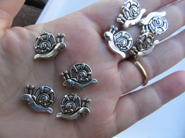 Six slithering snails....