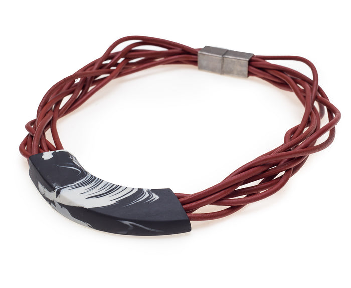 NIKORA / Brick leather cords porcelain necklace