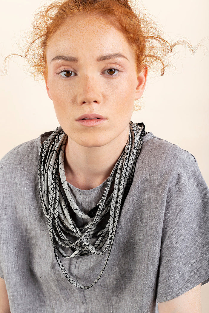Femi / Multi-stranded fabric necklace / Grey