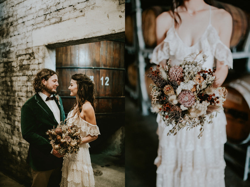 bride and groom holding dried flowers