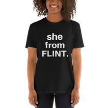 she from FLINT graphic t-shirt. Black with white lettering.