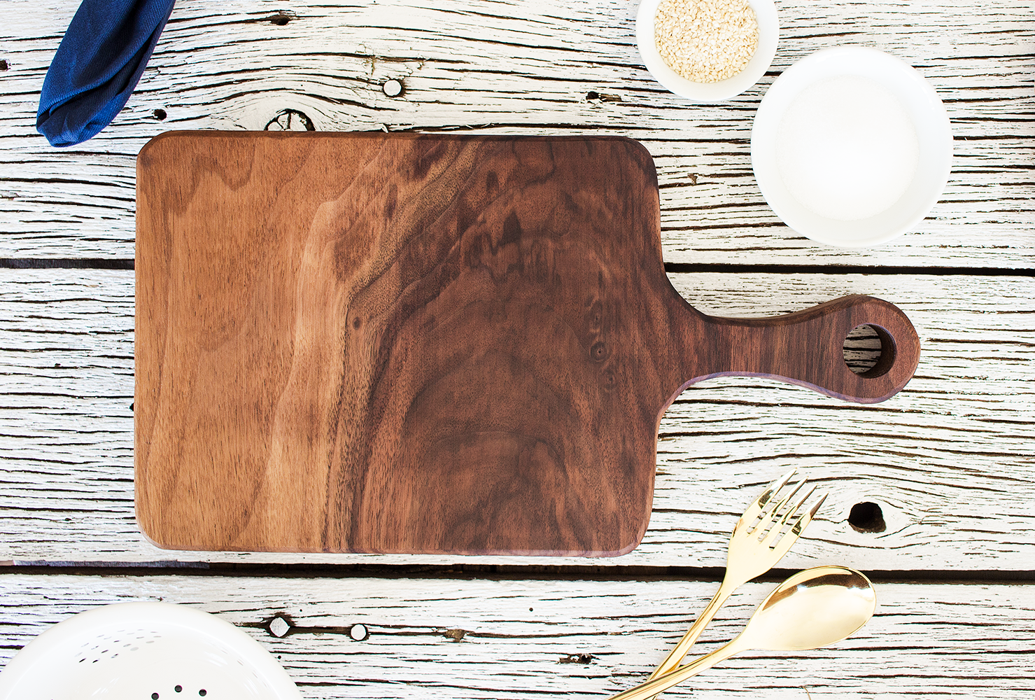 """Brentwood"" American Black Walnut Cutting Board hand carved by Smokestack Studios® in the USA. A beautiful addition to your kitchen or decoration on your dining table."