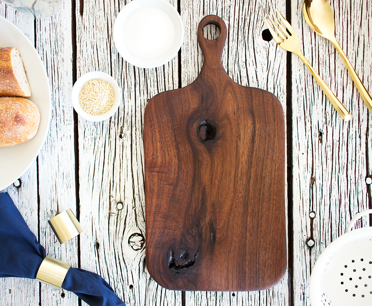 """Kirkwood"" Walnut Bread Board hand carved by Smokestack Studios in the Saint Louis MO A beautiful addition to the kitchen or a decoration on the dining table."