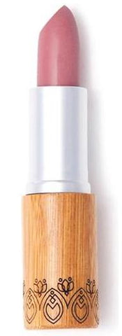 A medium pink lipstick with mauve undertones housed in a sustainable bamboo tube