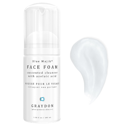 A bottle of unscented foaming cleanser for combination skin next to its product smear.