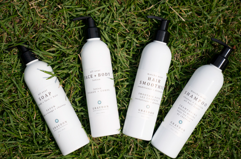 Graydon Skincare hair and body products laying in the grass