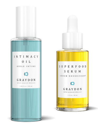 Intimacy Oil and Superfood Serum with shadow on white background