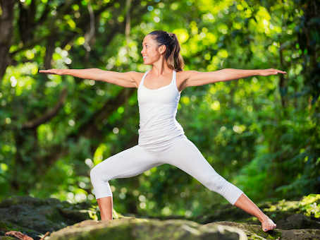 Woman Doing Yoga Outside Surrounded by Trees