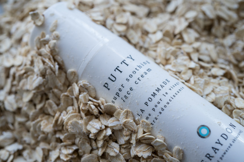 Bottle of Putty on a bed of oats