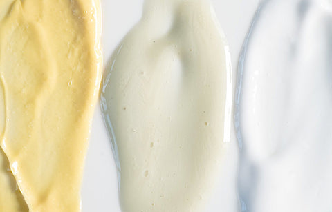A yellow, light green and white coloured face cream smear by Graydon Skincare