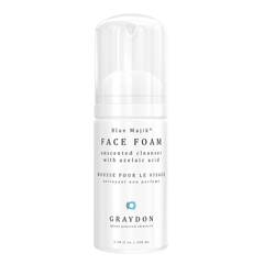 An oil-free and fragrance-free foaming cleanser in a white bottle againt a white background