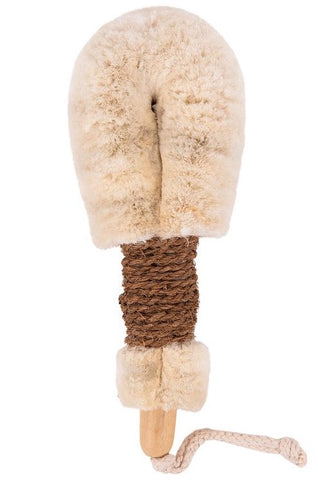A jute body brush with a beige cotton cord handle against a white background