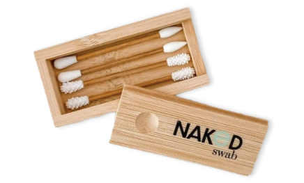 A set of 4 reusable bamboo ear swabs in an open bamboo box against a white background